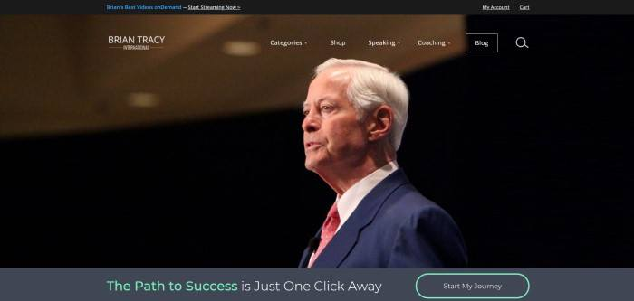 This screenshot of the home page for Brian Tracy has a black header above a transparent navigation bar and a large photo of white-haired man in a business suit, above a gray bar with green and white text inviting customers to start on the path to success and a call to action button.