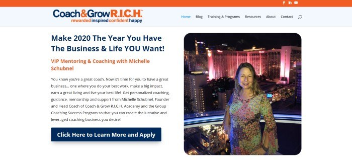 This screenshot of the home page for Coach And Grow R.I.C.H. has an orange header, a gray navigation bar, and a white main section with blue and orange text on the left side of the page inviting customers to work with a life coach, and a photo of a smiling woman standing on a balcony overlooking a cityscape at night on the right side of the page.