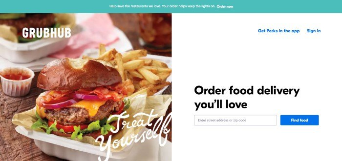 This screenshot of the home page for GrubHub has an aqua-colored header with white text inviting people to order above a split main section with a photo of a burger and fries on the left side of the page and a white section with black text inviting people to order food on the right side of the page, along with a search bar to get started.