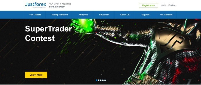 This screenshot of the home page for JustForex has a white header, a blue navigation page, and a dark photo of what looks like a superhero in dark clothes with green light in his hands, next to white text that reads 'Supertrader Contest'and a yellow call to action button.