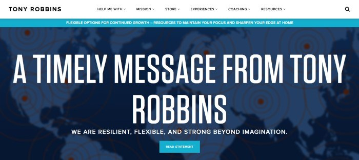 This screenshot of the home page for Tony Robbins has a white navigation bar above a blue announcement section and a darker blue main section with a map of the world in the background and white text in the foreground announcing a special message from Tony Robbins, as well as lighter blue call-to-action button.