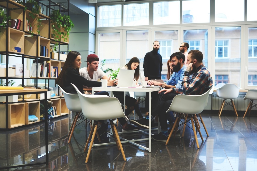 startup company in modern office with young people at table