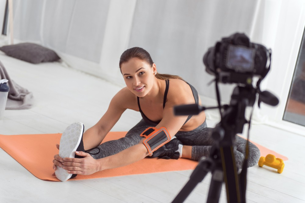 woman fitness blogger taking photos for her blog website
