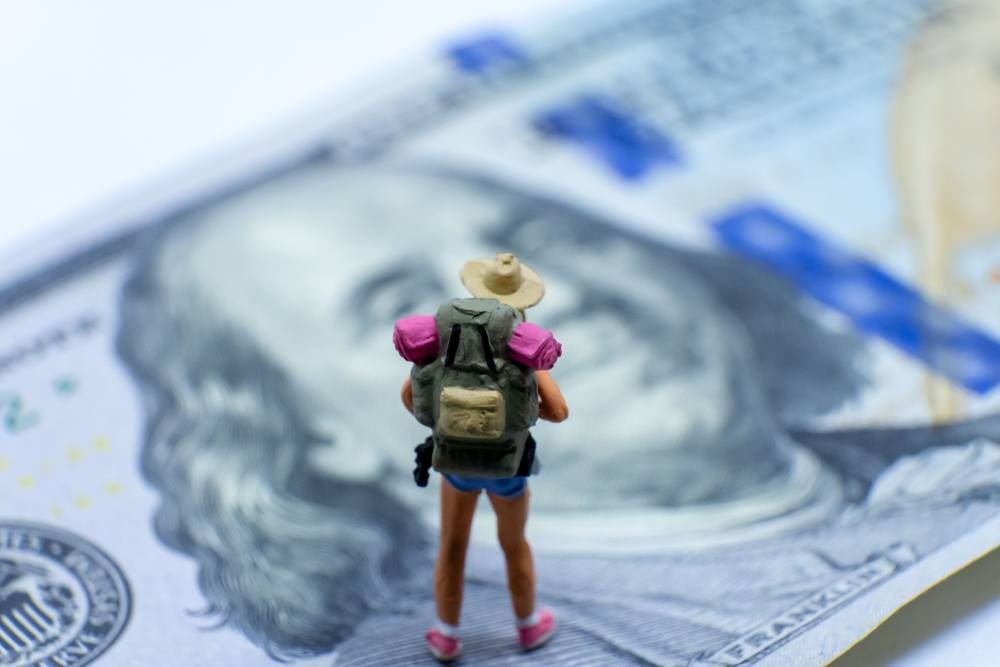 how much travel bloggers make concept figuring on dollar bill