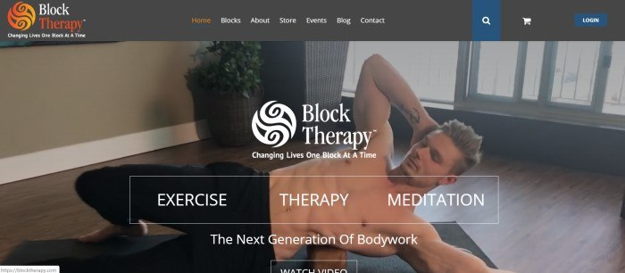 This screenshot of the home page for Block Therapy has a black header with an orange and white logo above a dark-filtered video shot of a shirtless man lying on a therapy block near a window, along with white text announcing Block Therapy options.