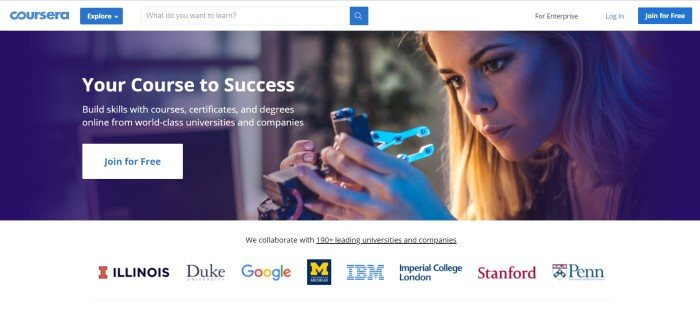 This screenshot of the home page for Coursera has a white search bar above a photo of a woman with blonde hair investigating a piece of technological equipment, along with white text announcing Coursera as a course to success and a white call to action button.