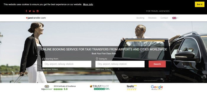 This screenshot of the home page for Jam Transfer has a black and white header and navigation bar above a photo of a smiling dark haired woman in black and white clothes walking toward a dark car where a smiling man waits, holding the door open for her, behind a gray and white search section with a red call to action button.
