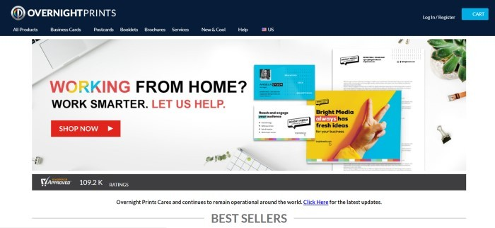 This screenshot of the home page for Overnight Prints has a black header and navigation bar with white text above a white main section with an overhead photo showing various printed materials, including brochures, flyers, and business cards in blue, yellow, and white, along with text in red, yellow, blue, and black and a red call to action button.