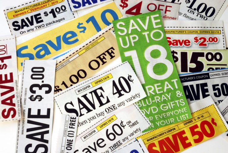 This photo shows a pile of printed paper ads and coupons in many colors, representing the best coupon affiliate programs