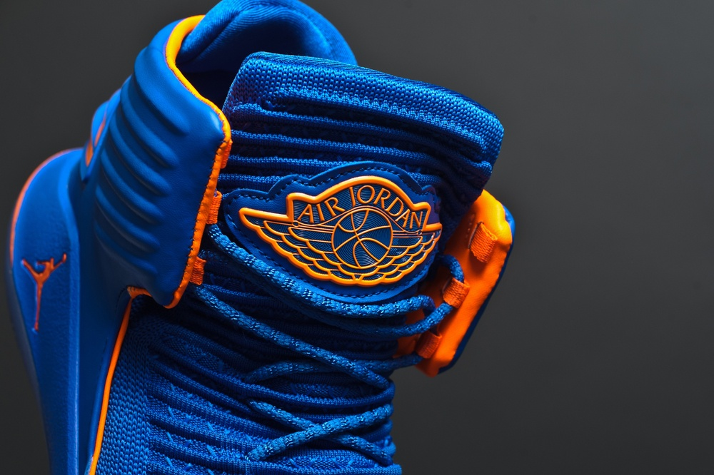 blue and orange air jordan with detail