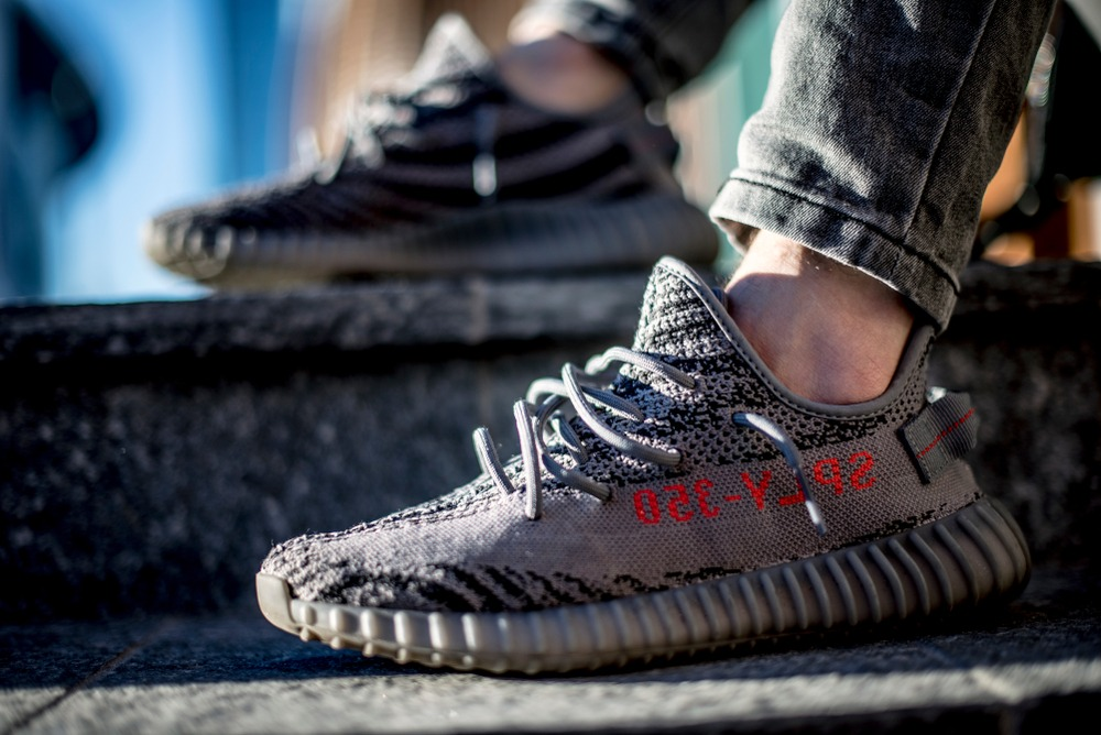 dark grey yeezy with red stitching