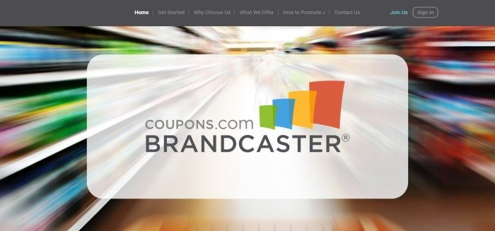 This screenshot of the home page for Brandcaster has a charcoal navigation bar above a blurry photo that appears to be a multi-colored grocery aisle behind a white text section with gray lettering announcing Brandcaster.