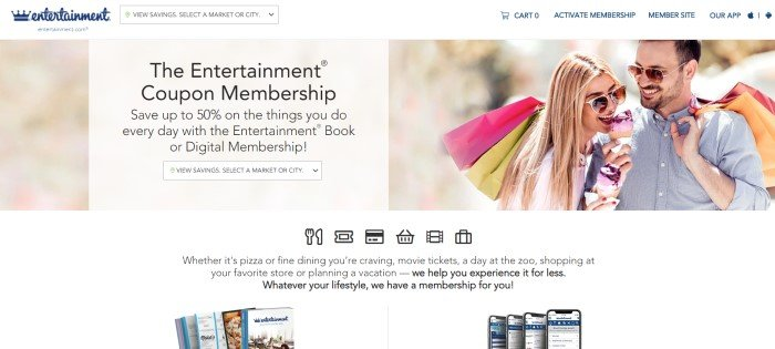 This screenshot of the home page for Entertainment Coupon Book has a white header, a photo of a smiling blonde woman and a dark-haired bearded man in sunglasses sharing a pink ice cream cone, as well as a beige text window with black text and a lower white section with black text, an image of coupon books on the left, and an image of coupon apps on mobile phones on the right.