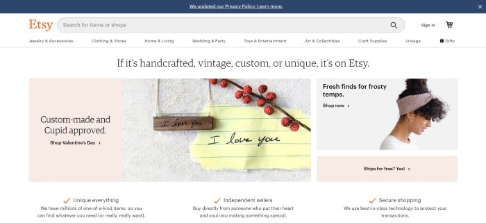 This screenshot of the home page for Etsy has a dark header above a white navigation bar and main section with a white background and product images with text describing them, including a wooden necklace and a woman's hair band being modeled by a woman with dark curly hair.