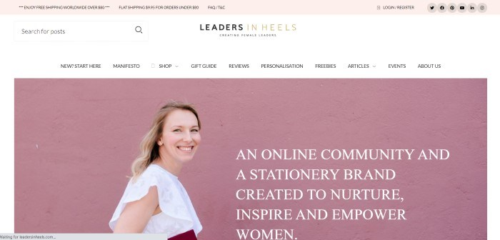 This screenshot of the home page for Leaders In Heels has a pale pink header, a white search and navigation bar, and a photo of a smiling blonde woman in a white shirt standing in front of a pink background, along with white text announcing the stationery products.