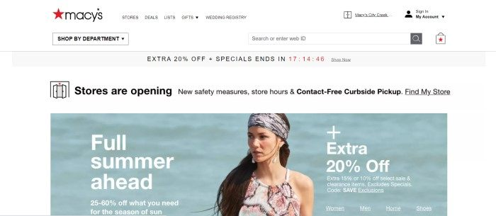 This screenshot of the home page for Macys has a white background and header with black text, a gray sales bar, and a photo of a brunette woman with a gray headscarf and pink and white printed dress standing in front of a body of water, along with white text announcing a summer sale.