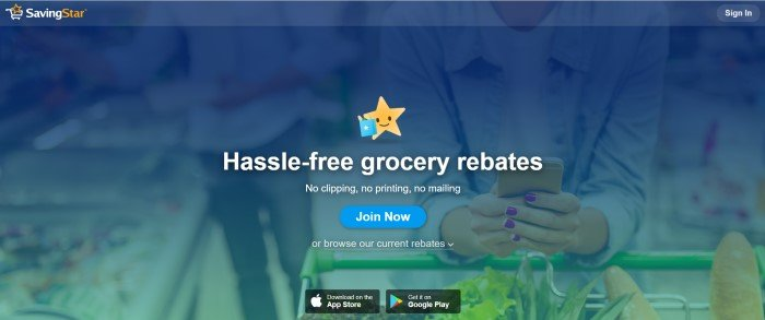 This screenshot of the home page for SavingStar has a dark blue filtered photo of a woman holding a cell phone as the background, along with a graphic of a yellow star with a blue shopping bag and white text announcing hassle-free grocery rebates, as well as a blue call-to-action button.