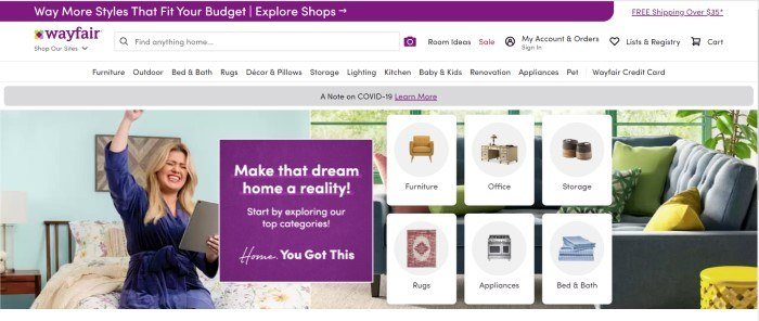 This screenshot of the home page for Wayfair has a purple header, a white search bar and navigation bar, and a photo of a smiling blonde woman in a blue robe sitting on a bed, holding a tablet and punching the air victoriously, along with several small product images and a purple ad section with white text.