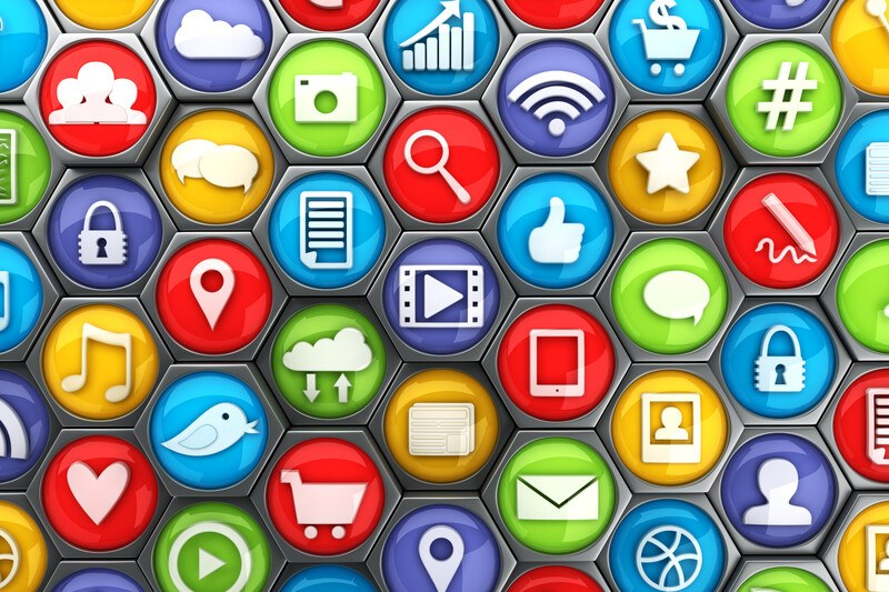This image shows several circles in red, purple, orange, green, blue, and yellow lying beside each other with white icons on them depicting several different social media platforms, representing the best social media affiliate programs.