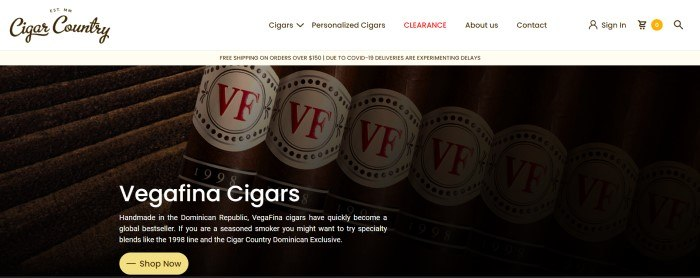 This screenshot of the home page for Cigar Country has a white navigation bar above a large close-up photo of cigars, along with white text describing them and a yellow call to action button.