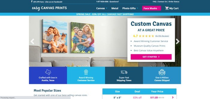 This screenshot of the home page for Easy Canvas Prints has a dark blue header and navigation bar above a white main section with a photo showing large canvas prints of family photos above a gray couch with yellow pillows, as well as a white text box with blue and yellow text and a pink call to action button, above a row of blue and white icons near the bottom of the page.