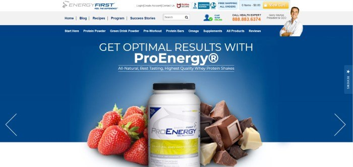 This screenshot of the home page for EnergyFirst has a white header with multicolored icons, a gray main navigation bar, a blue navigation bar, a photo of a smiling man in a white shirt in the upper right corner of the page, and a main blue section with white text in the upper center above a white jar of protein powder surrounded by strawberries and chunks of chocolate.
