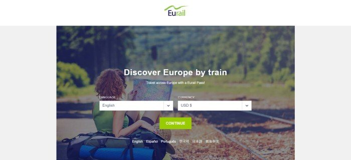 This screenshot of the home page for Eurail has a white header with a green and black logo, a gray background, and a large photo showing the back of a woman n a green shirt sitting near some blue bags next to a rail track running through a forest.