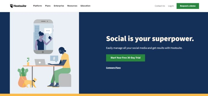 This screenshot of the home page for Hootsuite has a white navigation bar above a black main section with white text on the right side of the page and a white graphics section on the left side of the page depicting people using social media on mobile phones and laptops in gray, black, and yellow, as well as a green call to action button.