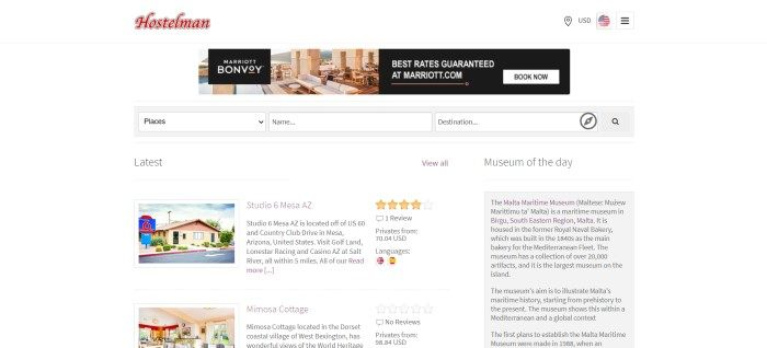 This screenshot of the home page for Hostelman has a white background with a red logo, a gray and white search bar, and a series of rows showing a photo of rental property on the left with text in black on the right, as well as a text section with a gray background on the far right side of the page.