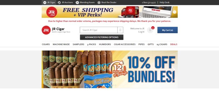 This screenshot of the home page for JR Cigar has a black header, a yellow and red sales section showing a red truck driving across the keyboard of a laptop with blue text announcing free shipping above a white main section with a black and white search bar, a navigation bar with black text, and a photo showing cigar bundles in colorful wrappers along with blue text announcing a sale.