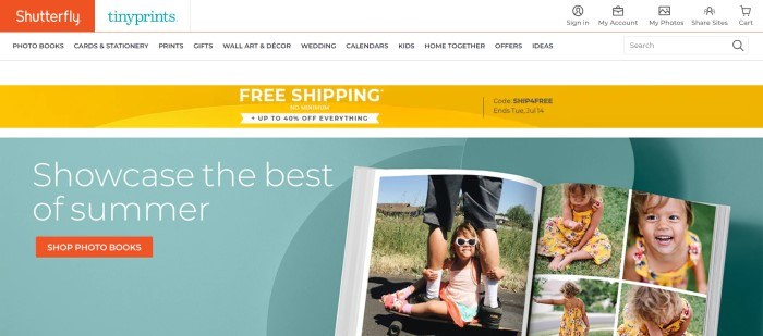 This screenshot of the home page for Shutterfly has an orange logo in the upper left corner, a white header and navigation bar, a yellow announcement bar, and a blue main section with white text and an orange call to action button on the left side of the page, along with several photos of a smiling girl in a yellow dress on the right side of the page.
