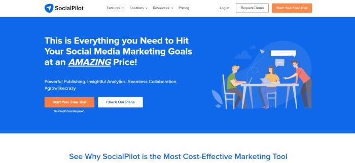 This screenshot of the home page for Social Pilot has a white navigation bar with an orange call to action button above a royal blue main section with white text on the left side of the page, an orange and a white call to action button, and a graphic of people working on laptops at a table on the right side of the page.
