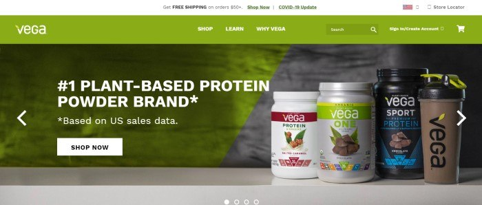 This screenshot of the home page for Vega has a white announcement header, a green navigation bar, and a large main section with a diagonal line running from the upper right to the lower left, which includes a green section with white lettering and a white call to action button on the left and a gray section with three jars in black and white with red, green, and teal labels on the right side of the page.