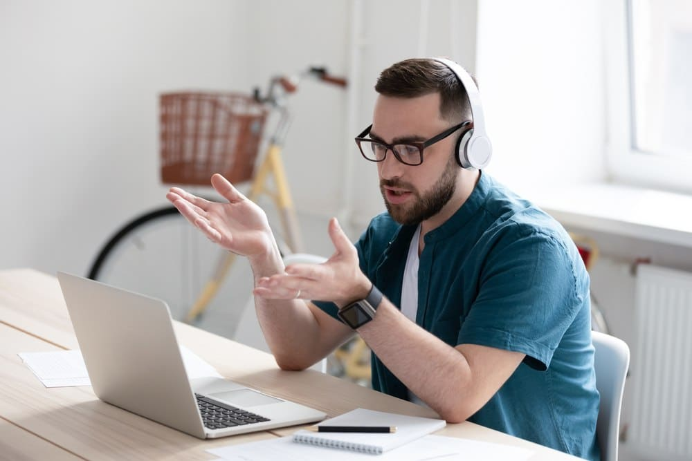 young man with beard taking online training course