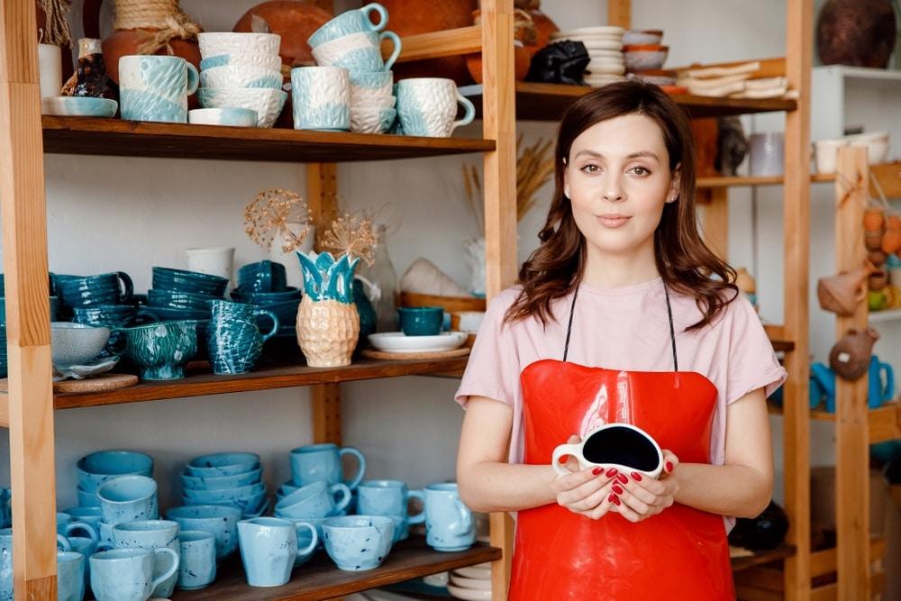 artisan craft ceramic maker with red apron