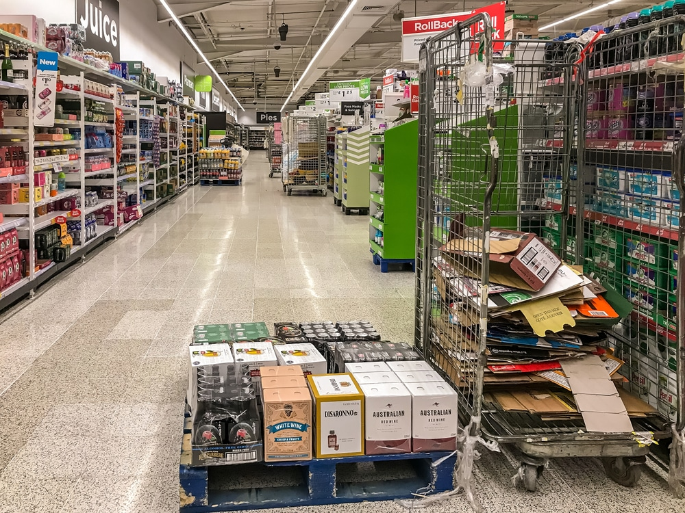 grocery store shelves being stocked at night