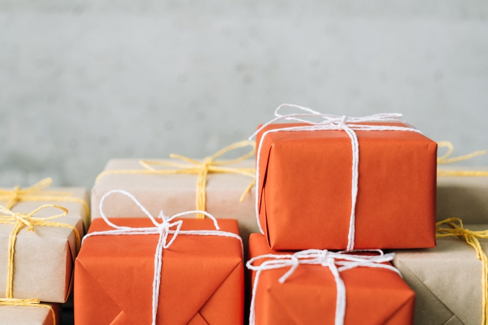 orange and tan boxes with handmade wrapping paper ready to ship
