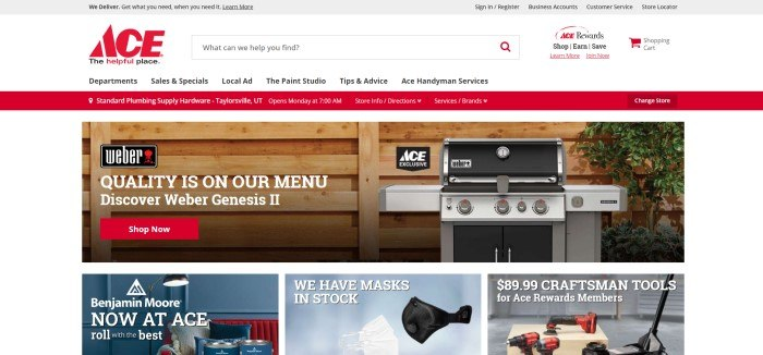 This screenshot of the home page for Ace Hardware has a gray header, a white navigation bar and search bar, a red announcement bar, and a white main section with a photo of a wooden wall with a large barbecue grill beside it, along with white text and a red call to action button, above a row of three smaller photos showing products the store carries, including face masks, drills, and paint.