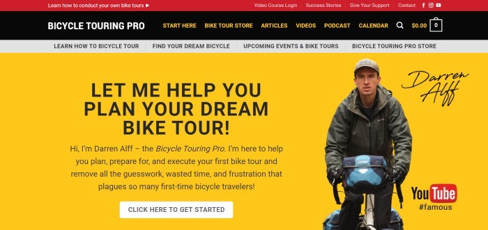 This screenshot of the home page for Bicycle Touring Pro has a red header, a black navigation bar with white and yellow text, a gray secondary navigation bar with black text, and a main section with a yellow background, black text and a white call to action button on the left side of the page, and a photo of a young man in a brown cap and jacket riding on a bike with a blue bag across the handlebars.
