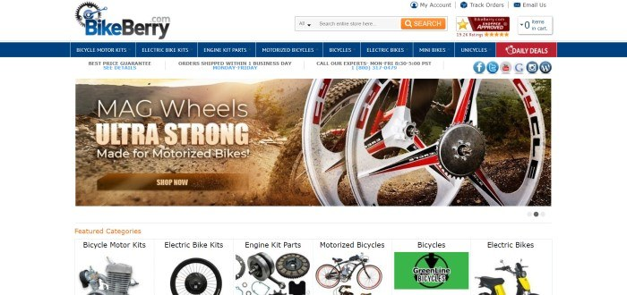 This screenshot of the home page for BikeBerry has a white header and search bar, a blue navigation bar with white text, a white announcement bar, a photo of motorized bike wheels as the bike drives up a dirt trail, above a row of photos with black text showing and labeling bicycle components.