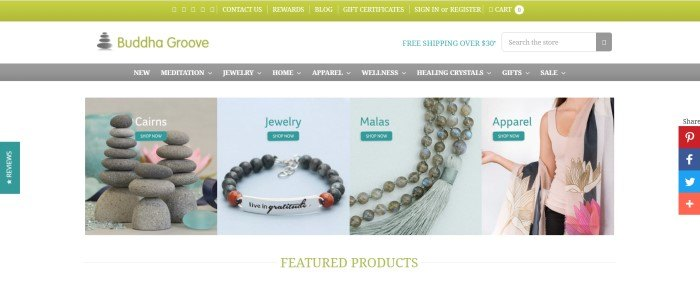 This screenshot of the home page of Buddha Groove has a green header, a white search bar, a gray navigation bar, and a white main section with product photos, including cairns, jewelry, beaded malas, and apparel (including a pink tank top).