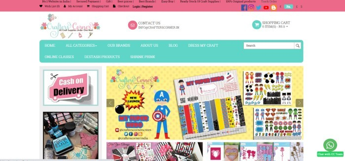 This screenshot of the home page for Crafters Corner has a pink header and primary navigation bar with black text, a white main section with an aqua and pink logo, an aqua secondary navigation bar with white text, and several multicolored photos showing crafting stickers, stamping pads with ink, and paper crafting supplies.