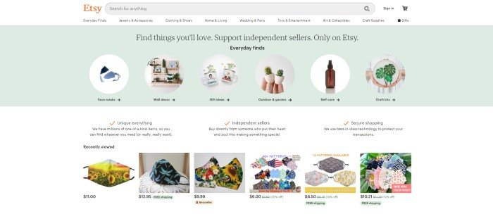 This screenshot of the home page for Etsy has a white search bar and navigation bar, a pale green main section with circular photos and text describing several different categories, a row of three columns of text in black sharing Etsy features, and another small row of photos showing various face masks for sale in Etsy stores.