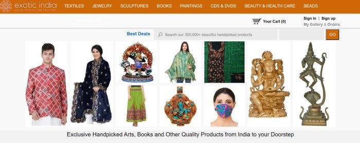 This screenshot of the home page for Exotic India Art as an orange navigation bar above a white main section that includes several photos of handpicked art pieces, such as statues and clothing.