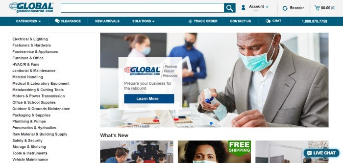 This screenshot of the home page for Global Industrial has a gray search bar, a blue navigation bar, and a white main section with a row of categories in black text on the left side of the page and a photo of a man in a face mask spraying disinfectant toward his keyboard, as well as a white text section with black text and a blue call to action button.