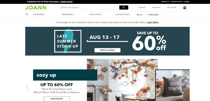 This screenshot of the home page for JoAnn has a black header, a white navigation bar and main page background, a green JoAnn logo, a dark green section with white text announcing a sale, and a row of photos showing fall-themed home décor.