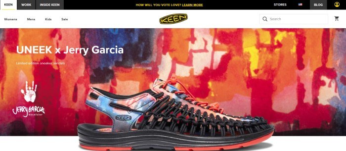 This screenshot of the home page for Keen has a black header, a white navigation bar, and a photo of a multicolored sandal in black, orange and blue in front of a painting in the same colors, along with white text on the left side of the page.