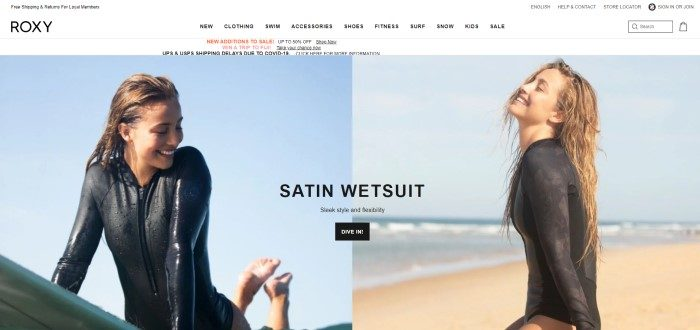 This screenshot of the home page for Roxy has a white navigation bar above two side by side photos showing a smiling woman in a black wetsuit playing in the water on the left side of the page and sitting on the beach on the right side of the page, along with black text and a black call to action button.