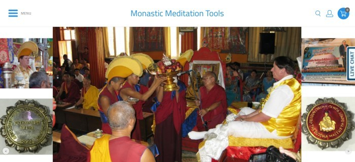 This screenshot of the home page for Shambhala Healing Tools has a white background, a large photo of some monks in red and blue clothing and yellow hats offering a golden fruit bowl to a man in white and gold clothing, and smaller photos of monastic life on the left and right sides of the page.