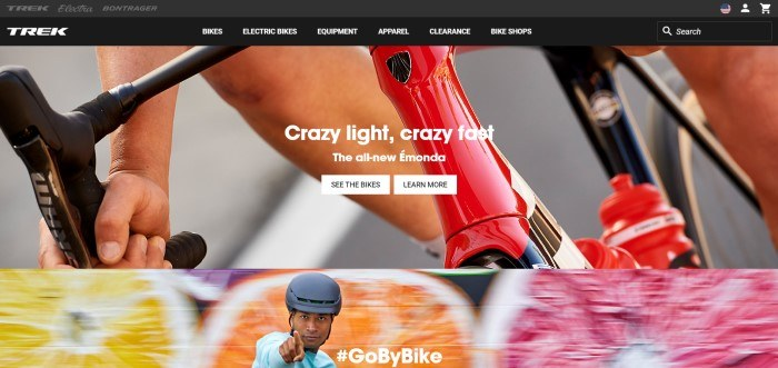 This screenshot of the home page for Trek has a black header and navigation bar with white text above a photo showing a closeup of the hands and knee of someone riding a red and black bike behind white text and two white call to action buttons, above a photo of a multicolored-background behind a smiling young cyclist in a blue shirt and black bike helmet.